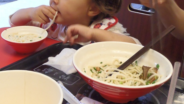 A Satisfied Guilin Noodle Eater