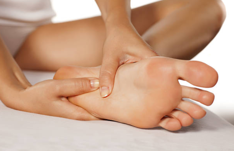 Acupressure on top of the foot