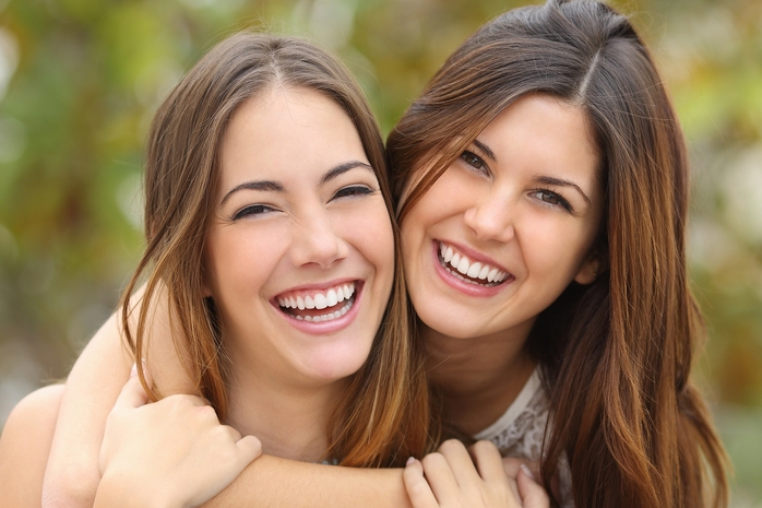 Bigstock: Two happy friends smiling
