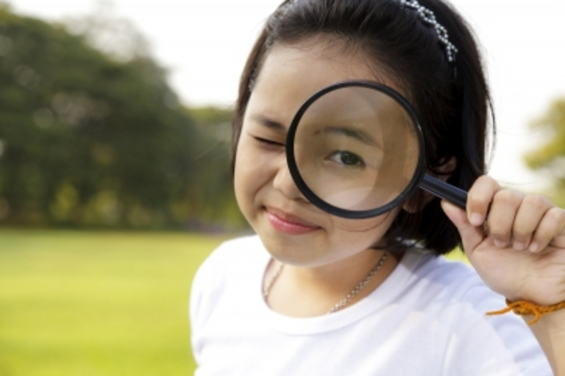 Child with Magnifying Glass  - Grow kids in the garden
