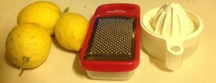Lemons, grater and lemon squeezer