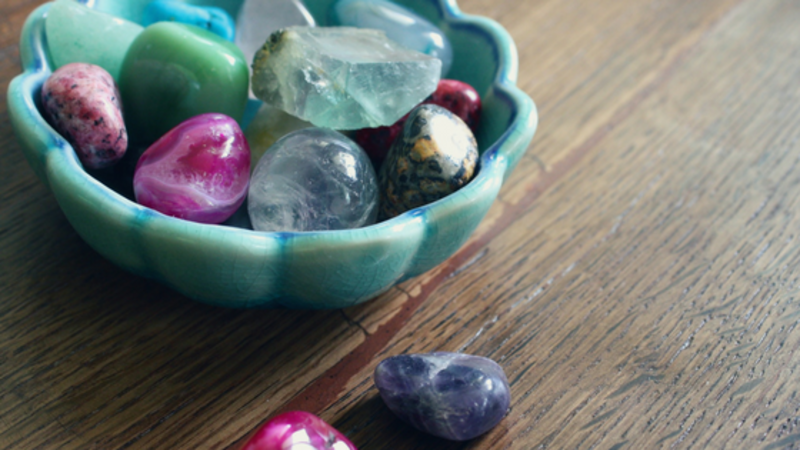 stones in a bowl  - Essential Healing Crystals for Your Home