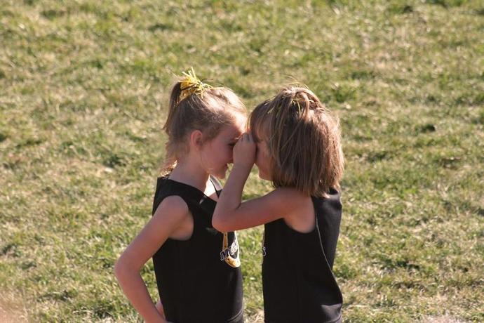 two girls in black shirts