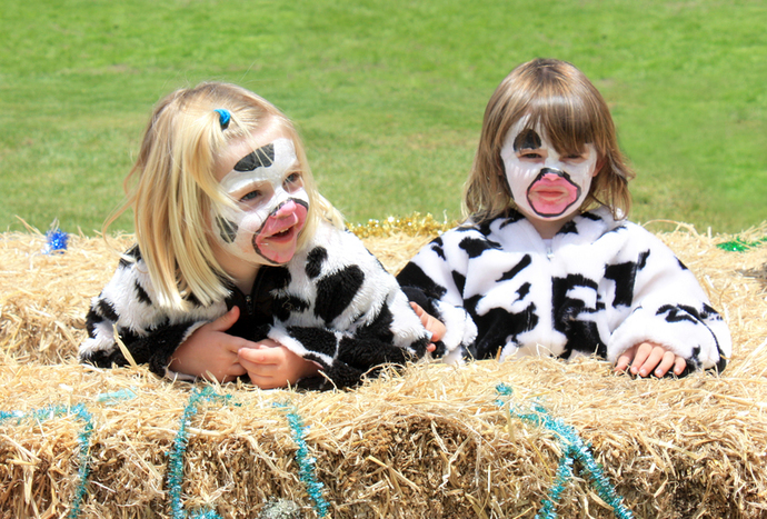 two little girls in cow suits