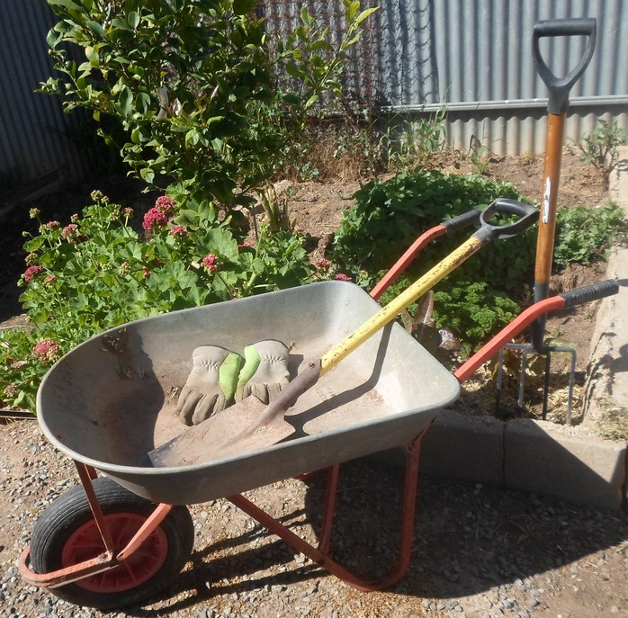 Wheelbarrow and tools